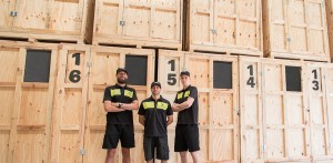image showing melbourne removals and storage team infront of storage boxes