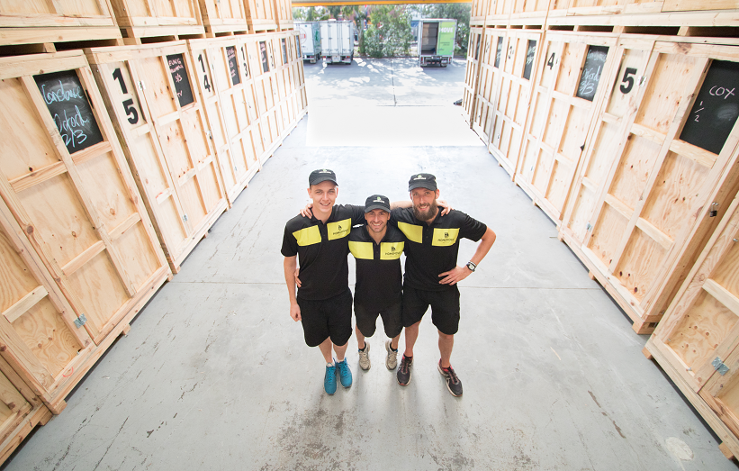 Melbourne Movers posing for photo in storage warehouse